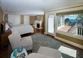 First floor master bedroom suite with custom closet, separate sitting area, gas fireplace and French doors to the deck.