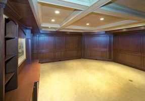 On the lower level is a paneled billiard room, separate family or media room and exercise room.