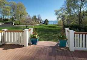 Enjoy unobstructed ocean views, a sloping lawn, perennial gardens and wraparound deck.