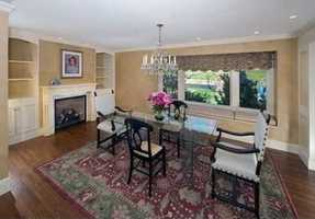 A formal dining room or library with fireplace and laundry room complete the first floor.