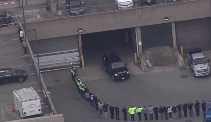 Law enforcement line up to salute as the van exited the hospital.