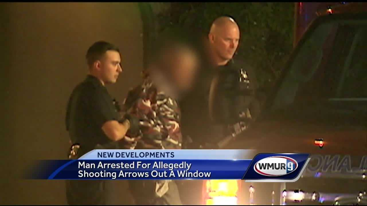 Police say a man shot arrows out of an apartment building in Manchester.