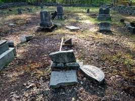 Several headstones in the Old Richardson Cemetery on Douglas Road were toppled and others were broken into several pieces.
