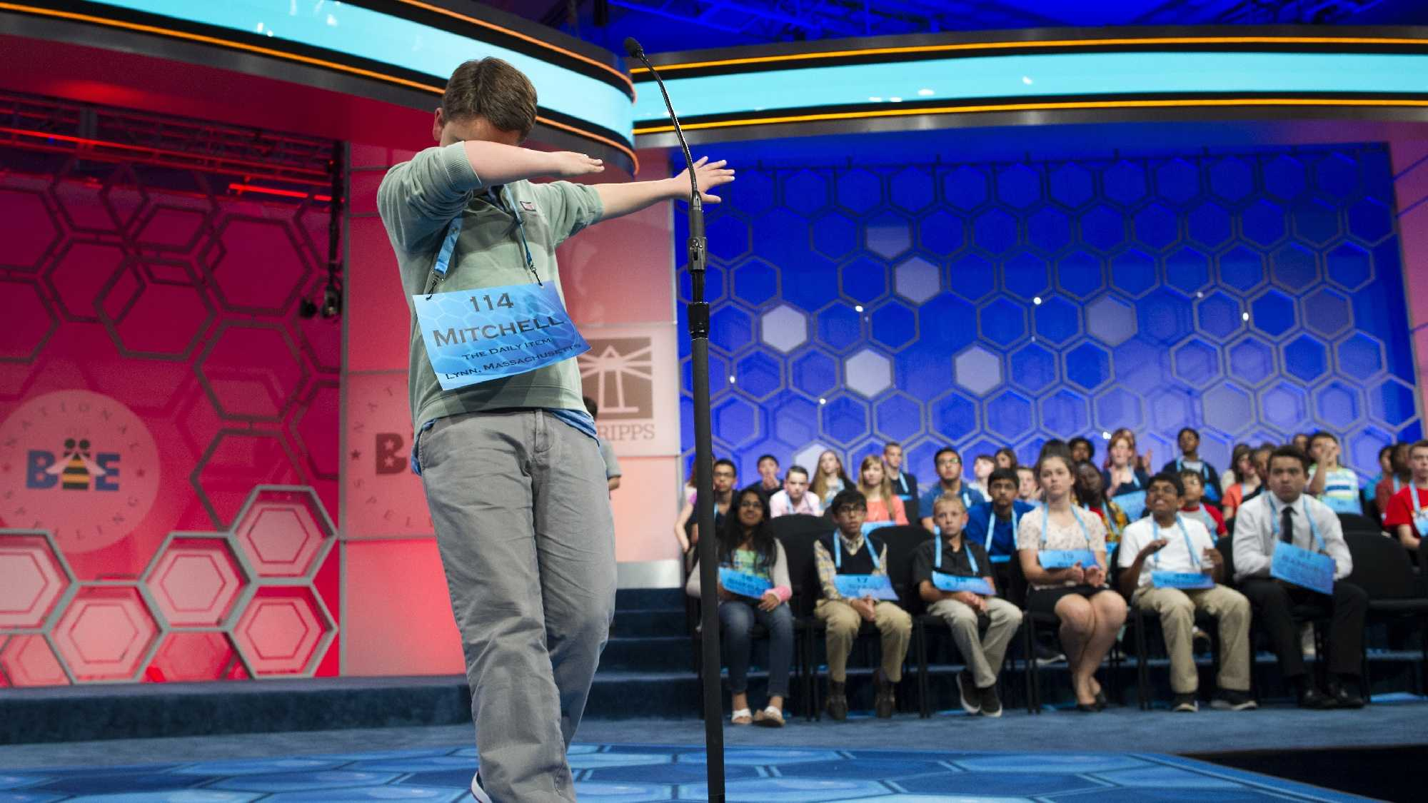 Mitchell Robson, 14, of Danvers, Mass., steps backwards while celebrating correctly spelling his word during the preliminary round three of the Scripps National Spelling Bee in National Harbor, Md., Wednesday, May 25, 2016.