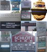 Signs that honor the fallen officer.