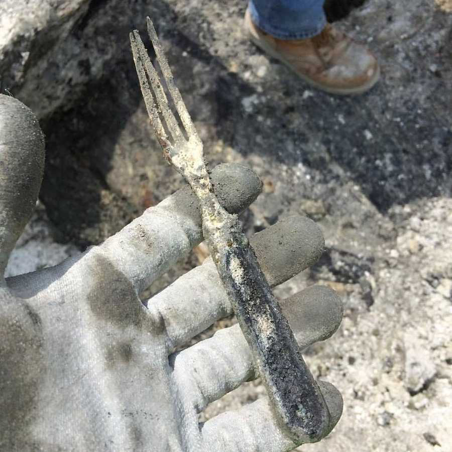 Intact 19th century fork found next to a stack of burned dishes in the rear hull of the ship.