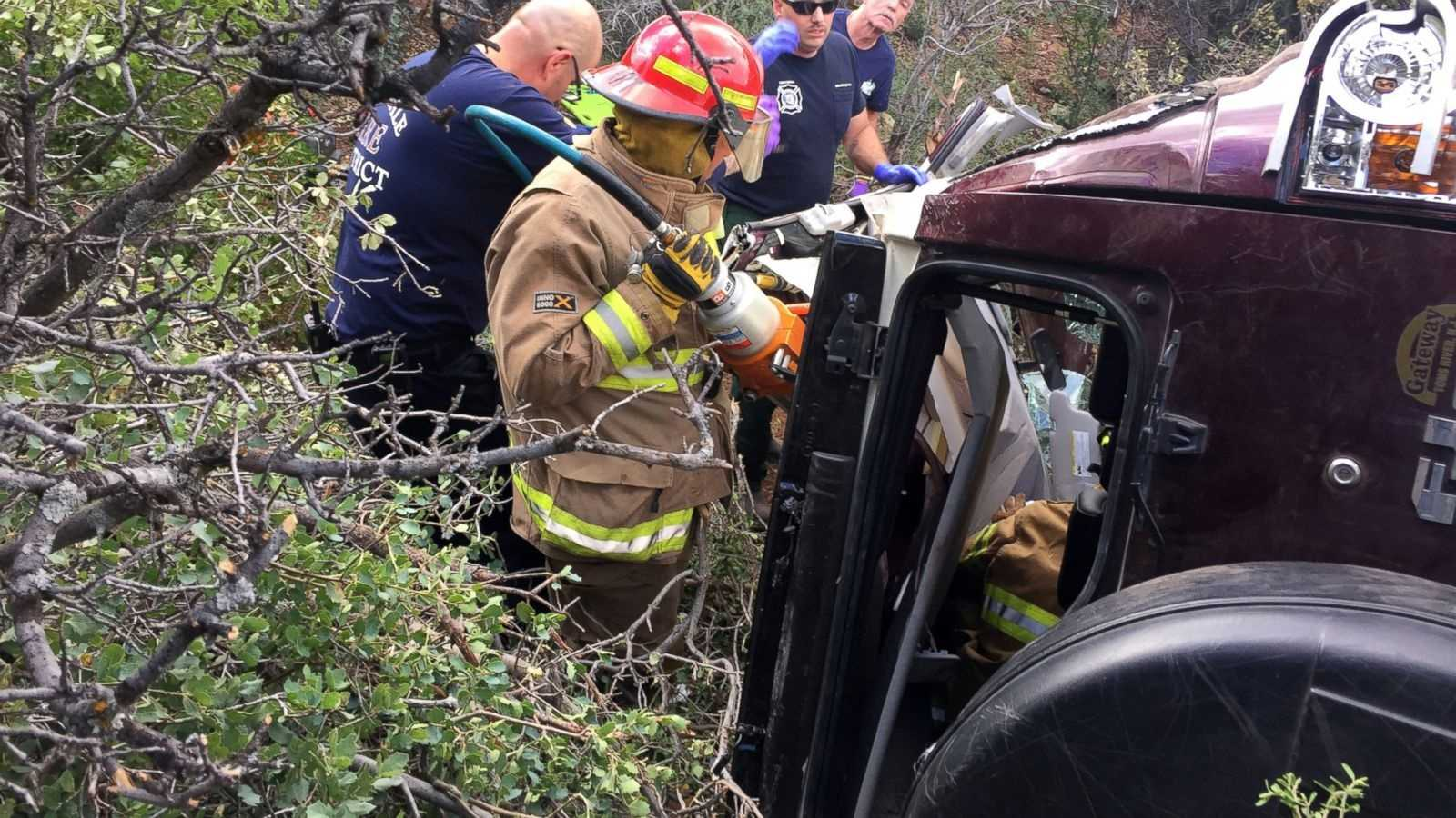 This photo provided by Kim Moore shows firefighters working to extricate a 50-year-old man from his crashed car on Mingus Mountain in Yavapai County, Arizona on Friday, May 27, 2016. Authorities say a man trapped in his crashed vehicle on a central Arizona mountain for three days was rescued thanks to a couple taking sightseeing photos.
