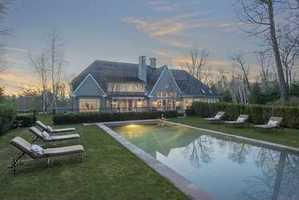 Enter through a long driveway and arrive at a spectacular Shingle and Stone Estate on 3 acres with a gorgeous pool and utterly romantic pool house set amidst beautiful gardens and abutting hundreds of acres of conservation land.