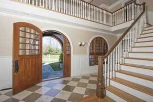 Enjoy an elegant cherry paneled study, grand two story front hall with limestone floors, luxurious Master Suite, gym and media room.