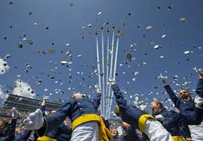 """The Air Force Thunderbirds fly overhead as graduating cadets celebrate with the """"hat toss"""" after graduation ceremonies at the 2016 class of the U.S. Air Force Academy, Thursday, June 2, 2016, in Colorado Springs, Colo."""