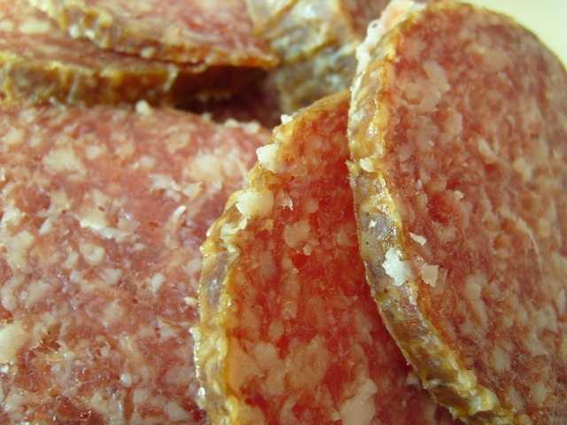 Salami: One slice of cooked salami has 296 mg of sodium.