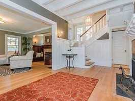 Welcome to this turn-of-century graciously renovated Colonial, 5 bedroom home.