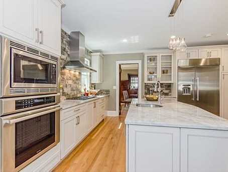 New gourmet eat-in kitchen with oversized island, lots of cabinetry, prep sink, wet bar, and Thermidor SS appliances.
