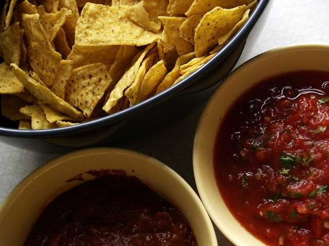 Tortilla chips: 699mg of sodium per bagSalsa: 256mg of sodium per tablespoon