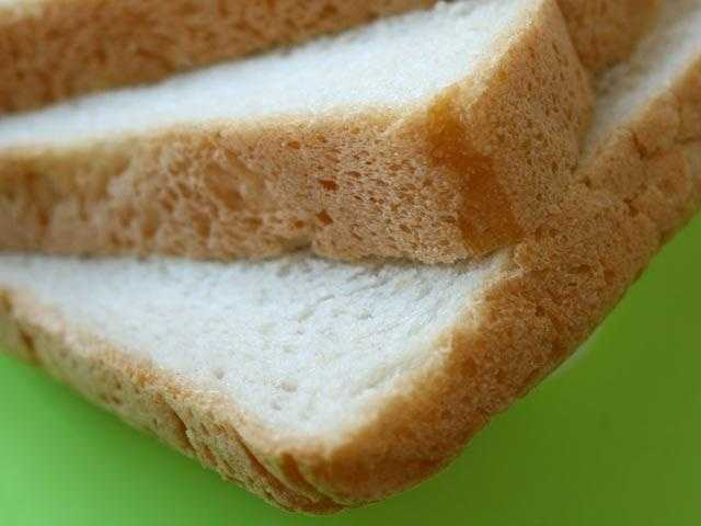 White bread - Sugar and oil in white bread can cause pancreatitis in dogs.