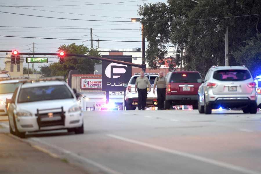 Police cars surround the Pulse Orlando nightclub, the scene of a fatal shooting, in Orlando, Fla., Sunday, June 12, 2016.