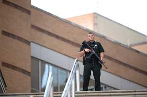 A police officer stands guard outside the Orlando Regional Medical Center hospital after a fatal shooting at a nearby Pulse Orlando nightclub in Orlando, Fla., Sunday, June 12, 2016.
