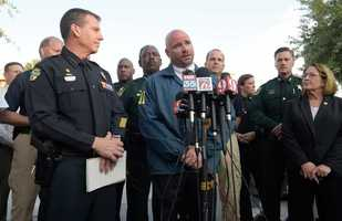FBI assistant special agent in charge Ron Hopper, center, answers questions from members of the media after a fatal shooting at Pulse Orlando nightclub in Orlando, Fla., Sunday, June 12, 2016. Listening are Orlando Police Chief John Mina, left, and Orange County Mayor Teresa Jacobs.