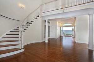 The home features a two story entry with sweeping staircase.