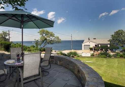 Expansive water views, lovely seaside gardens, handsome granite/bluestone terrace and attached two car garage complete this offering.