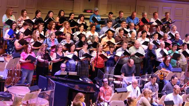 In this particular rehearsal, the Pops are playing Broadway show tunes with the accompaniment of a choir.