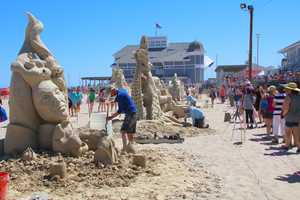 200 tons of imported sand was dropped on Hampton Beach for sculptors to create works of art out of sand.