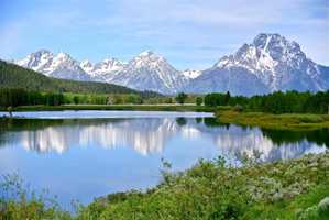 Grand Teton National Park in Wymoing has 2000 miles of trails and is known for the Teton Range, whose nine peaks are part of the Rocky Mountains