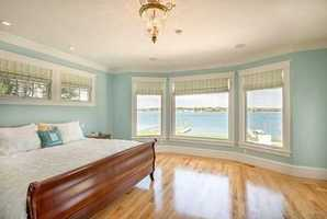 The Master Suite offers stunning bay views,2 walk in closets and a stunning en suite bath with marble floor.