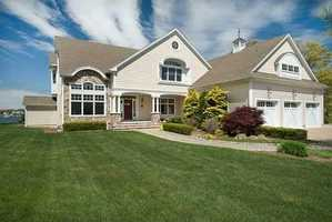 Magnificent, direct bayfront residence set high atop a bluff overlooking scenic Onset Bay with a view to the Cape Cod Canal.
