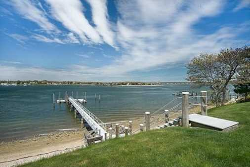 The Cape Cod Canal and Islands in close proximity and this lovely waterfront home await discerning nautical enthusiasts.