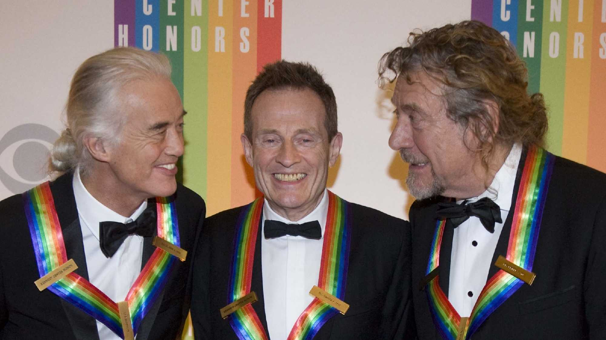 2012 Kennedy Center Honorees and members of the band Led Zeppelin, from left, Jimmy Page, John Paul Jones, and Robert Plant chat on the red carpet after arriving at the Kennedy Center for the Performing Arts for the 2012 Kennedy Center Honors Performance and Gala Sunday, Dec. 2, 2012 at the State Department in Washington.