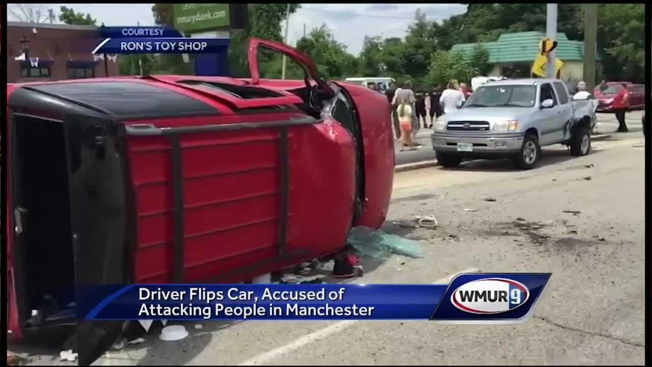 A car hit several vehicles Friday on Elm Street in Manchester before flipping onto its side, and police said they had to use a stun gun to subdue the driver.