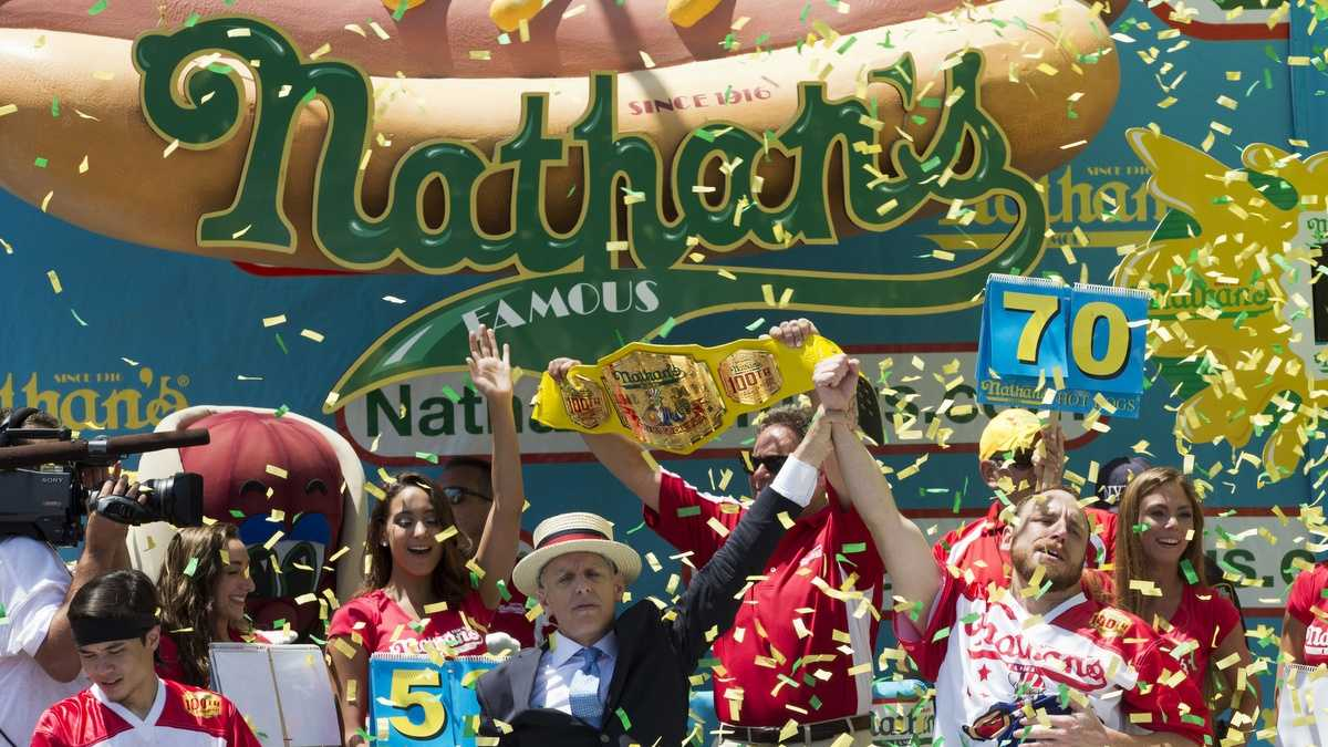 Joey Chestnut, right, is declared Nathan's Famous Fourth of July International Hot Dog Eating Contest men's competition winner, Monday, July 4, 2016, in New York. Chestnut came in first eating 70 hot dogs and buns in 10 minutes. Matt Stonie came in second eating 53 hot dogs and buns in 10 minutes.