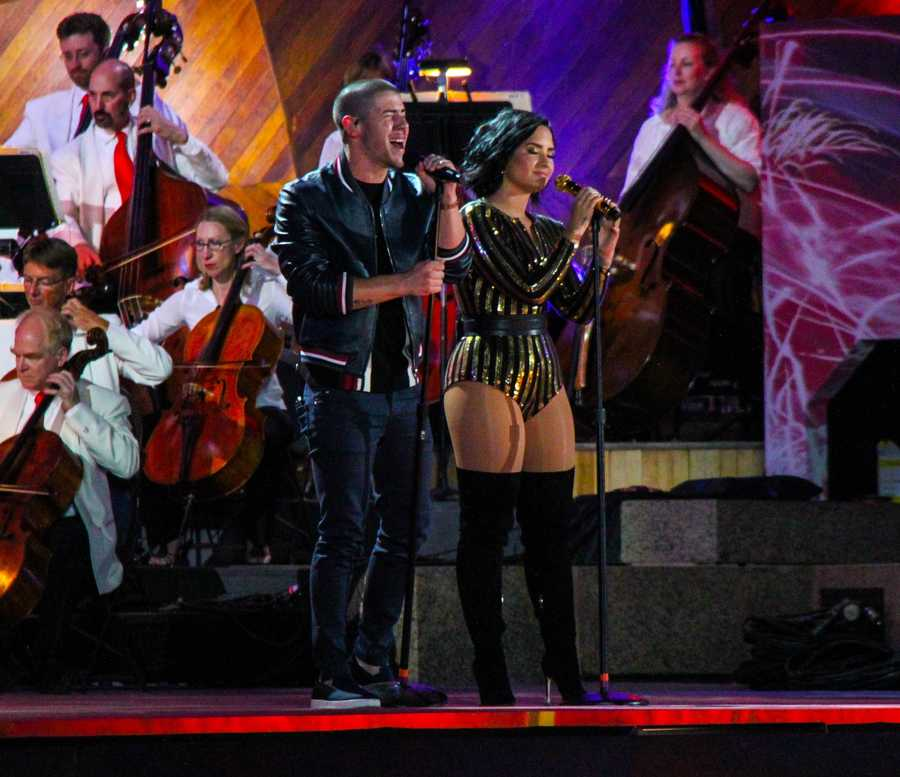 "Nick Jonas and  Demi Lovato sing ""America the Beautiful"" at the Boston Pops Esplanade Concert on July 4, 2016"
