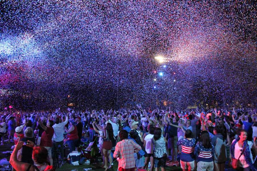 Confetti showers the crowd at the conclusion of the concert.