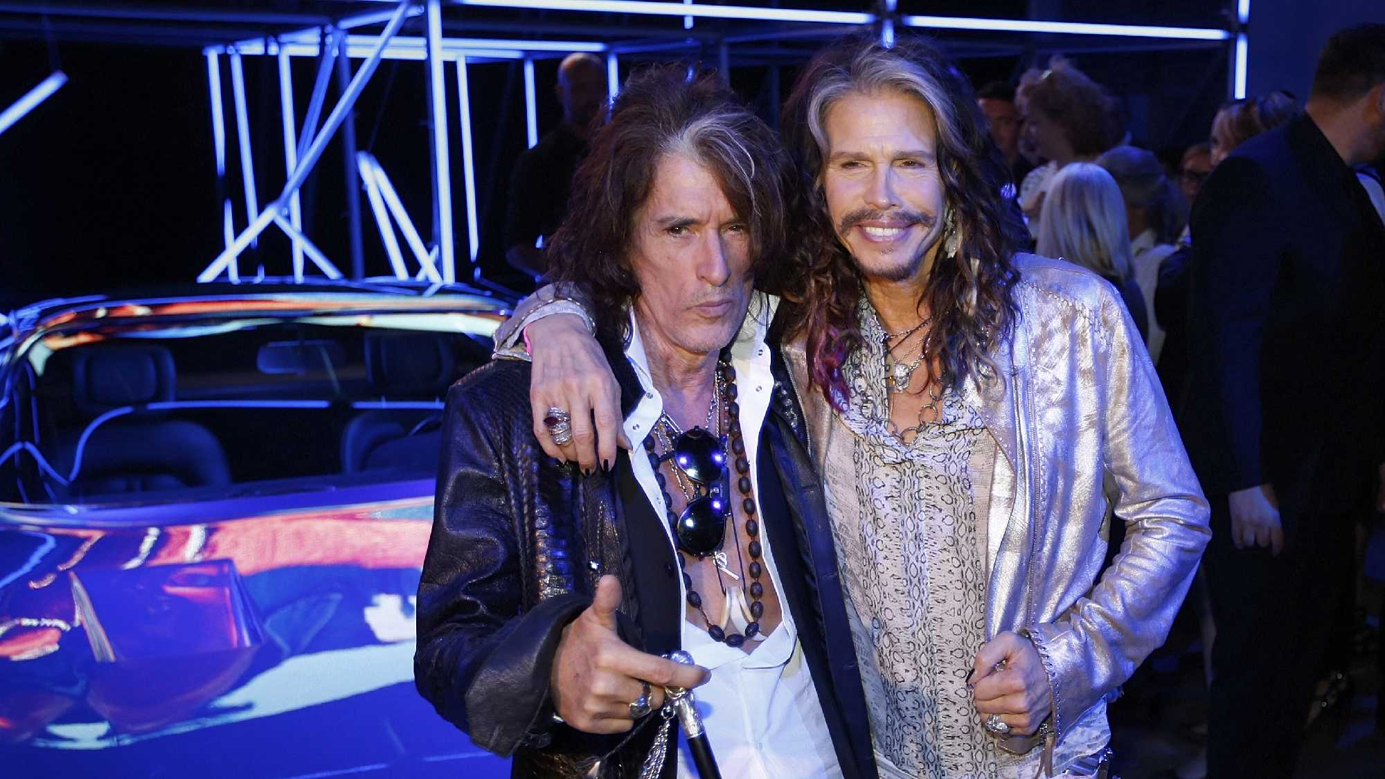 US Aerosmith rock band guitarist Joe Perry, left, and singer Steven Tyler pose as they wait for the start of the Roberto Cavalli men's Spring-Summer 2015 collection, part of the Milan Fashion Week, unveiled in Milan, Italy, Tuesday, June 24, 2014.