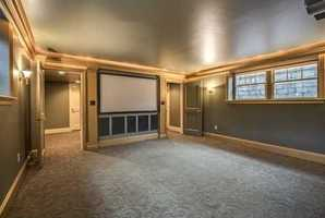 Lower level Home theater with service Kitchen and second Mudroom makes entertaining a breeze!