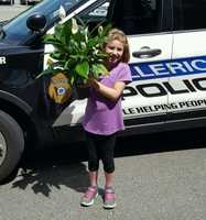 """""""Another great young lady from Billerica, Kayla Tolliso, delivering a gift to the PD today! Much appreciated!,"""" Billerica Police."""