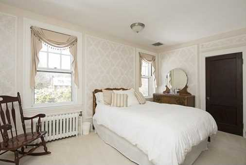 Three additional bedrooms and a marble bathroom complete this floor.