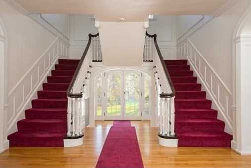A double bridal staircase welcomes you into the elegant entry foyer.