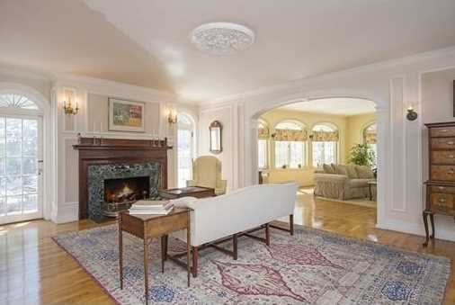 The family room has a 3 sided exposure and French doors leading to a patio.