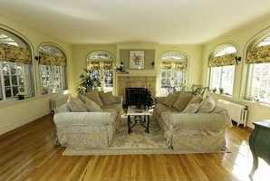 The oversized living and dining rooms have significant moldings, French doors & fireplaces.