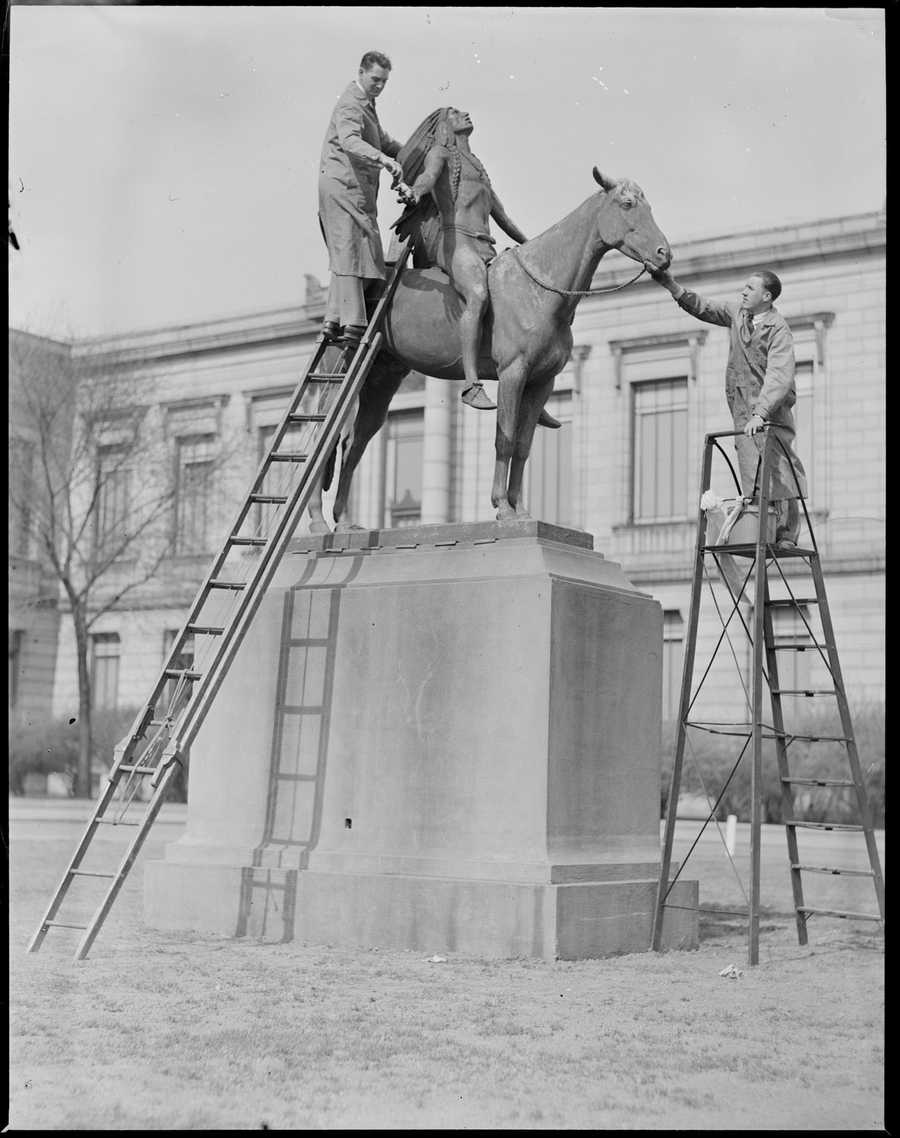 """Men cleaning""""Appeal to the Great Spirit"""" outside Museum of Fine Arts, Boston. April 1931."""