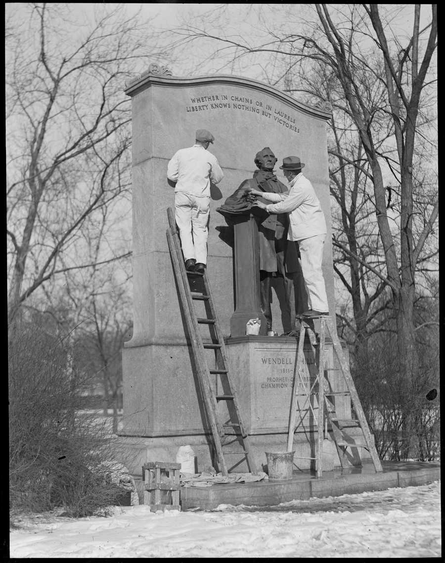 Wendell Phillips statue being cleaned, 1917-1934 (approximate)