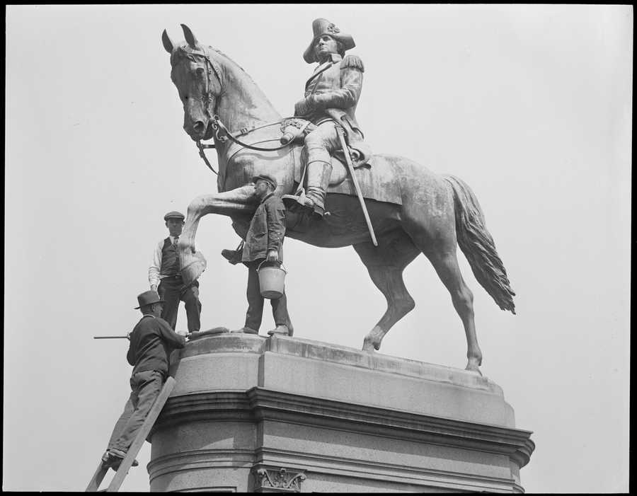 George Washington statue being cleaned up by park men, April 27, 1929