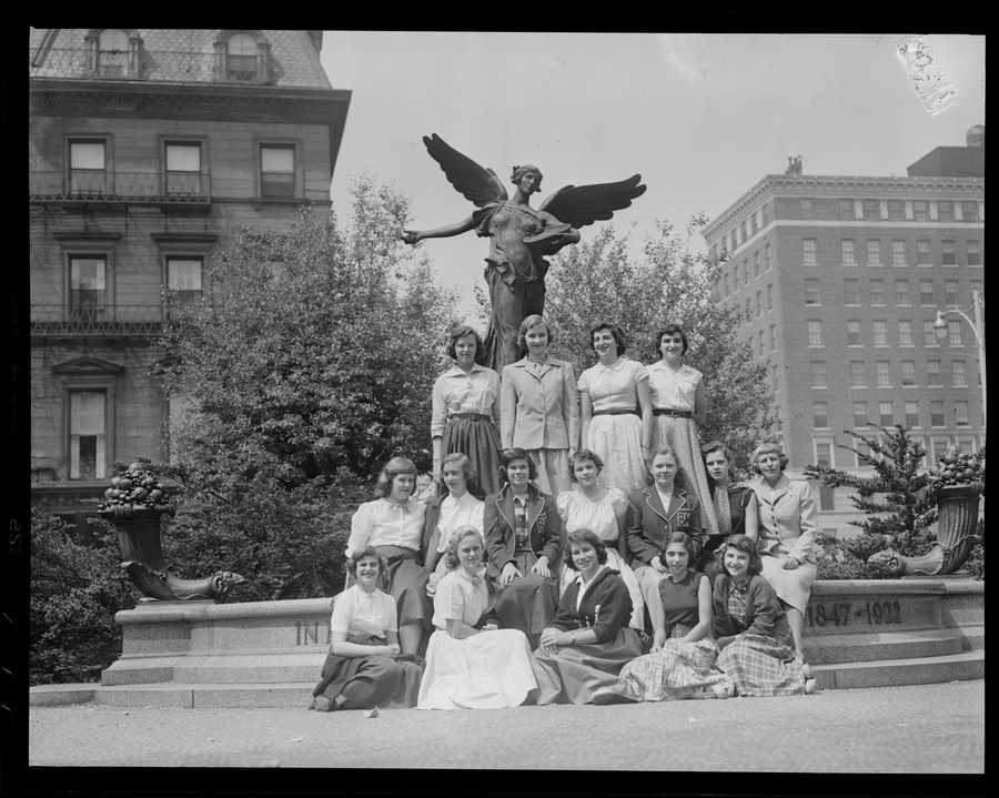 Group of women pose in front of the George Robert White Memorial, Public Garden. 1934 - 1956