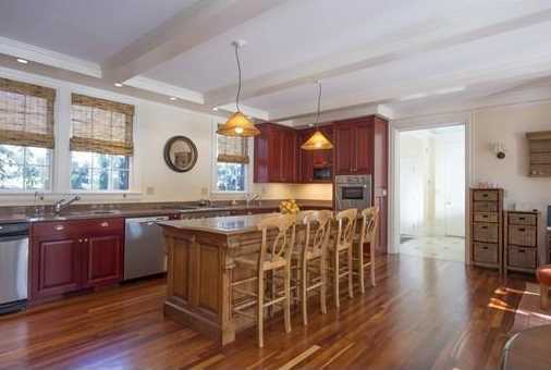 The eat in kitchen has all the bells & whistles including, a butlers pantry, an oversized island, double ovens and french doors opening to a large patio.