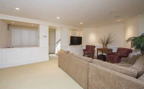 Lower level has an additional 950 sq ft of finished space offering a 2nd family room, wine cellar & storage.