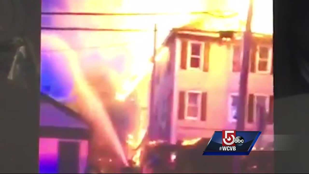 Heavy flames ripped through a multi-family home in Lowell Saturday morning.