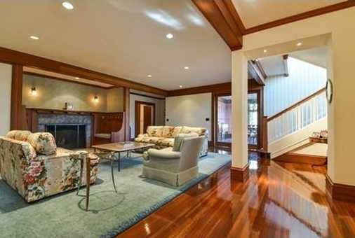 Renovated kitchen family room addition w/ fireplace expands back of house w/ southern exposure.